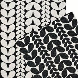Tapis de salon tressé noir et blanc