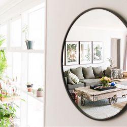Grand miroir rond cadre noir