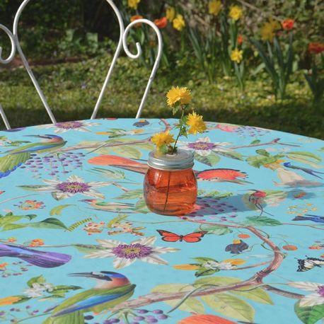 Fleur de Soleil nappe ronde enduite turquoise oiseaux
