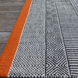 Orange woven rug Tryptik